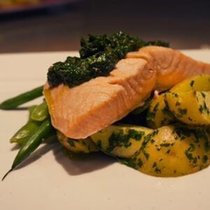 Steamed salmon with baby potatoes, green beans and salsa verde
